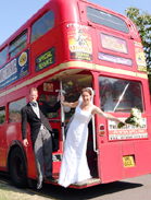 Bride and Groom on a red London bus