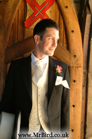 Groom by the church door