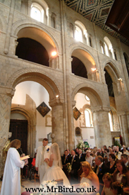 an unusual angle of the abbey church during a weddding service
